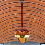 Jeff Koons, Hanging Heart (Gold/Magenta) , 1994-2006, 114 5/8 × 110 1/4 × 40 in., High-chromium stainless steel with transparent color coating and yellow brass © Jeff Koons